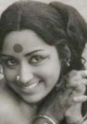 Prameela smiling while wearing a nose-jewel