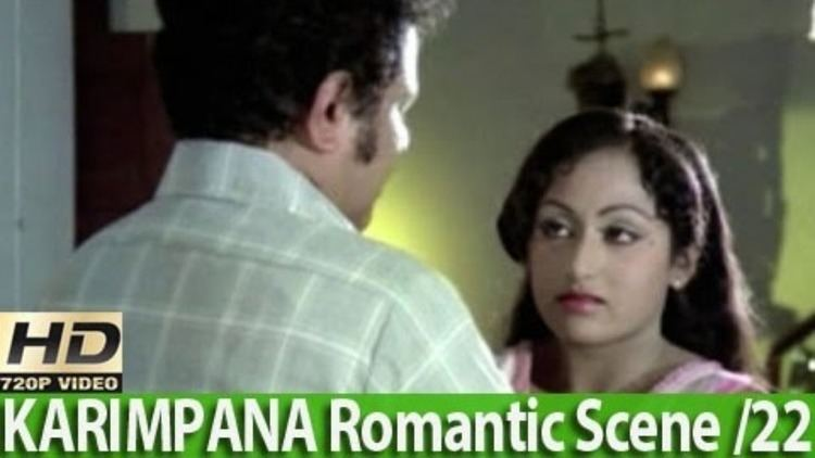 Prameela looking at the man in front of her in a movie scene from Karimpana (1980 Indian Malayalam film)