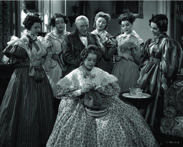 Pride and Prejudice (1940 film) movie scenes The Bennett Family Heath Angel Marsha Hunt Edmund Gwenn Greer Garson Ann Rutherford Maureen O Sullivan and sitting is Mary Boland