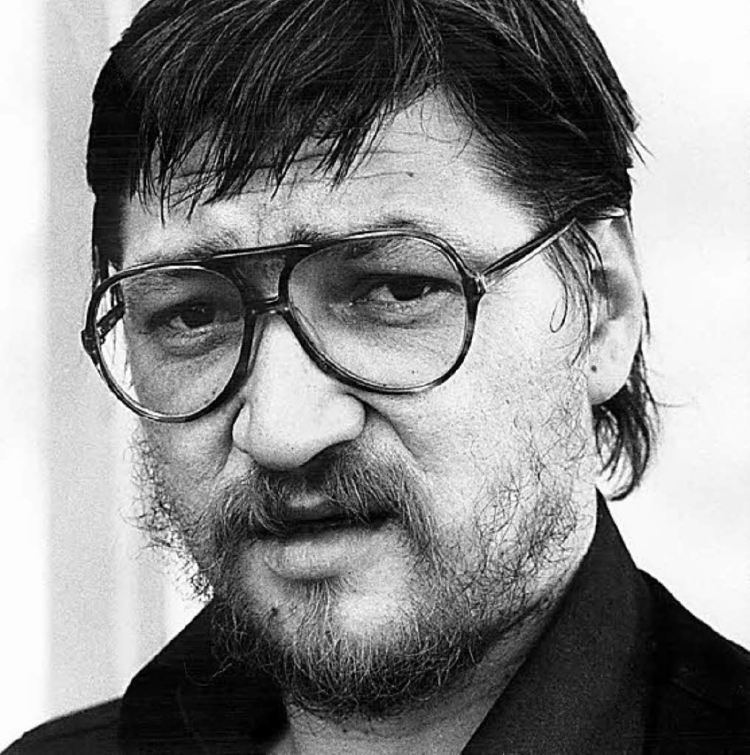 Rainer Werner wearing a black shirt and a pair of eyeglasses