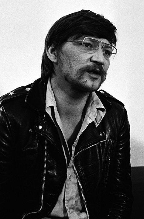 Rainer Werner wearing a black jacket and a pair of eyeglasses