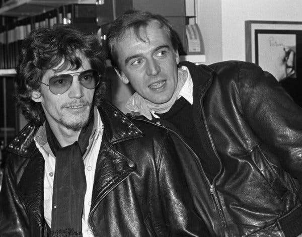 Robert Mapplethorpe, left, at one of his exhibitions with Rene Ricard in 1977.