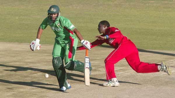 Richard Muzhange Zimbabwe bowler Richard Muzhange R fields off his own bowling as