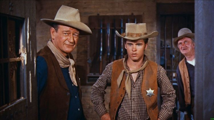Rio Bravo (1959 film) movie scenes When the dimwitted Joe Burdette Claude Akins shoots and kills a man in a saloon fight he is arrested by Sheriff John T Chance John Wayne
