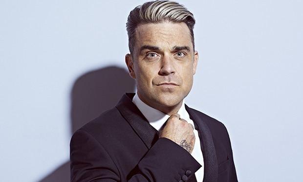 Robbie Williams Robbie Williams unveils surprise new album Music The