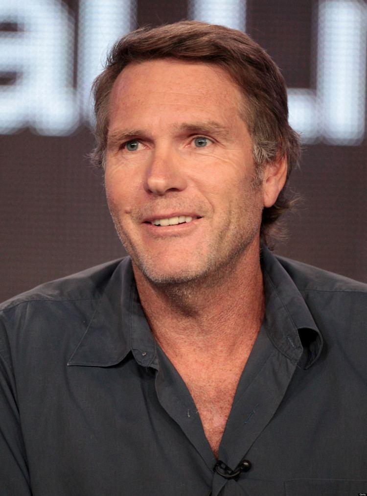 Robert Taylor wearing a black long sleeves