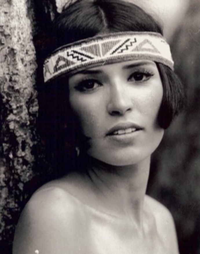 Sacheen Littlefeather in her fierce look while wearing headband