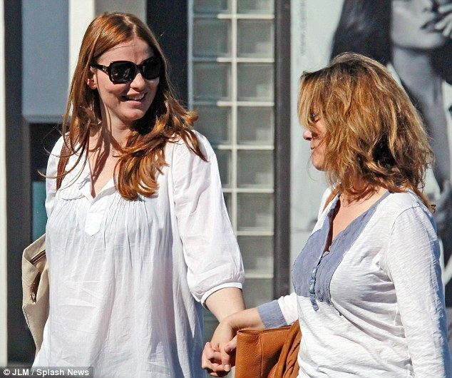 Saffron Burrows Saffron Burrows engages in a very public display of affection with
