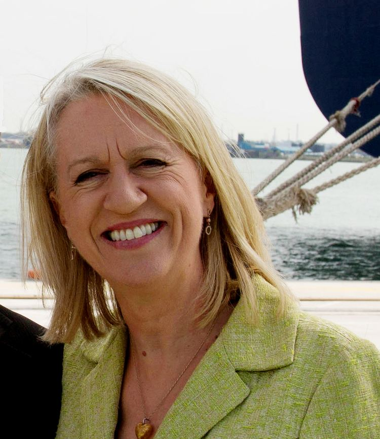 Smiling Sally Taylor on the bay