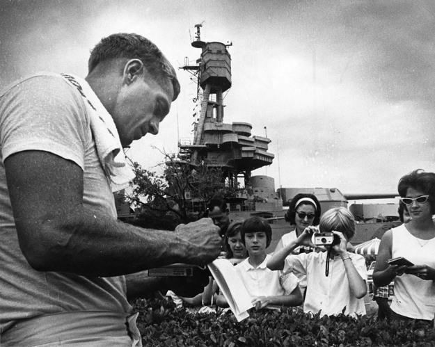 Sand Chronicles movie scenes Actor Steve McQueen signs autographs while visiting the USS Texas to film scenes from the movie The Sand Pebbles August 1966 Richard Pipes Chronicle