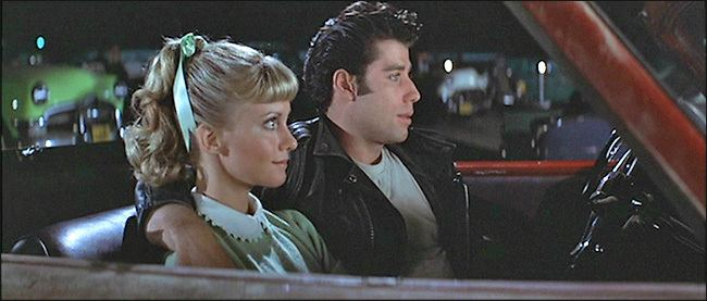 Seeing Stars (film) movie scenes In the drive in movie scene Danny gets fresh with Sandy prompting her to leave then Danny sings the song Sandy while cartoon hot dogs dance on the