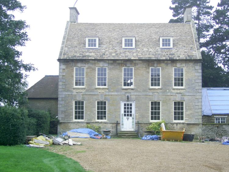 A front view of Stanwick Hall, Northamptonshire with visible building materials.