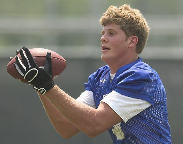 Tanner Hawkinson Photo Tanner Hawkinson catches a ball during Kansas