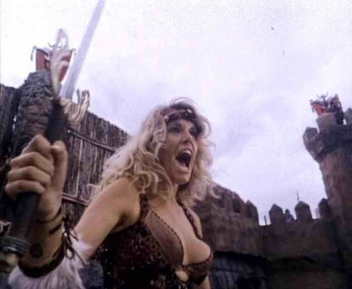 Team Queen movie scenes Clarkson steals the movie she knows that she s a powerful Barbarian Queen and plays it straight She s great in the fight scenes and proves that she can be