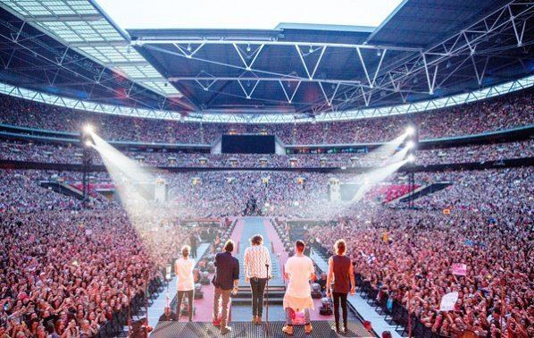 The Band Concert movie scenes The five piece British Irish pop band One Direction is shown in a scene from their movie One Direction Where We Are The Concert Film