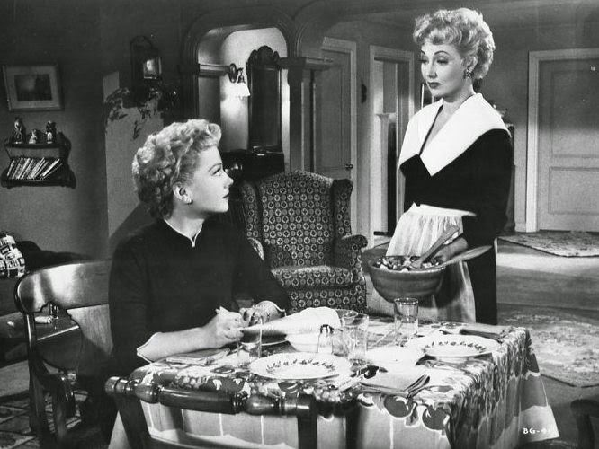 The Blue Gardenia (1953 film) movie scenes Unfortunately her beau is half a world away serving in the military But that doesn t keep her from preparing a candle lit dinner