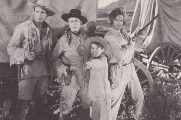 The Painted Stallion movie scenes Above from left to right Ray Corrigan Hoot Gibson Sammy McKim and Hal Taliaferro in The Painted Stallion Republic 1937