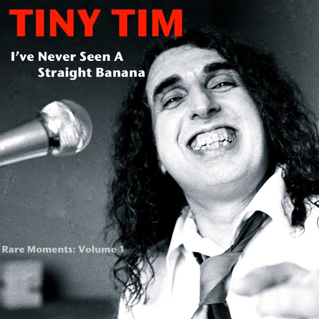 Poster of Tiny Tim with curly hair, wearing long sleeves and a tie with a microphone in front of him.