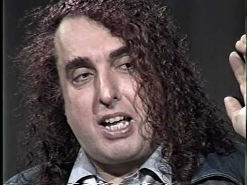 Tiny Tim with curly hair.
