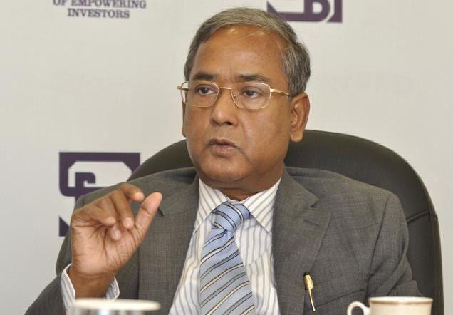 U. K. Sinha SEBI chief warns companies against manipulating bourses