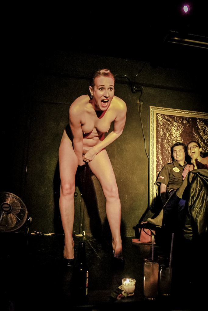 Ursula Martinez performing on stage while naked.