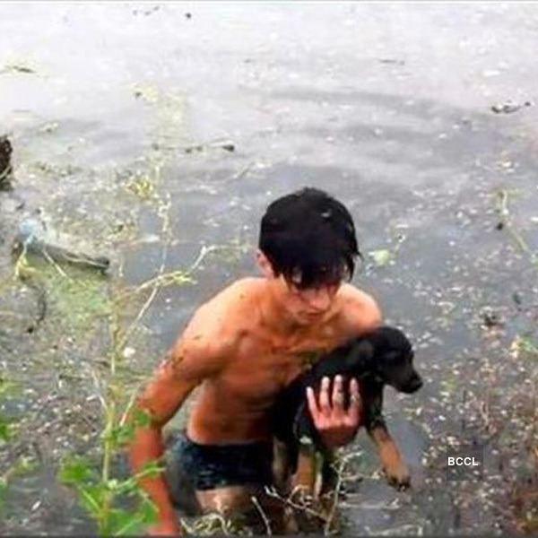 Vladimir Maksimov Teenager Vladimir Maksimov saw a puppy drowning in flood waters So