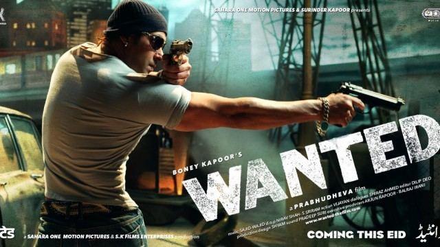 Salman Khan holding a gun while wearing black shades, a black beanie, and a gray t-shirt in the 2009 film Wanted