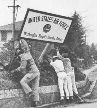 Washington Heights (Tokyo) Workmen remove a Washington Heights entrance sign Flickr