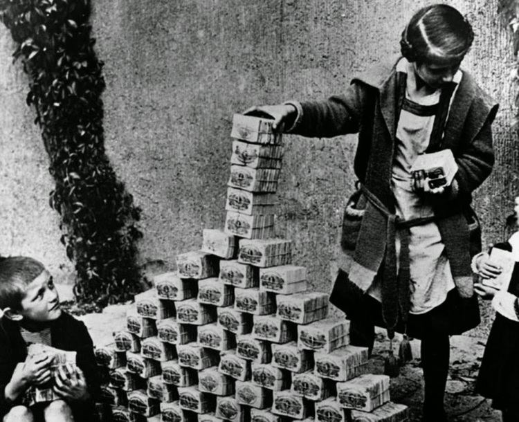 Weimar Republic Children playing with stacks of hyperinflated currency during the