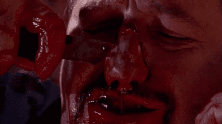 Wishmaster 4: The Prophecy Fulfilled movie scenes But there are some satisfyingly gross moments like the face peel scene typical of the franchise and some genie wish induced self mutilation
