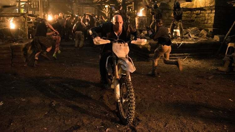 Vin Diesel riding in a motorcycle in a scene from the 2017 movie, XXX: Return of Xander Cage